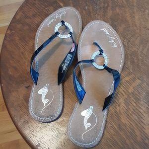 Ladies lightly worn flip flops by baby phat